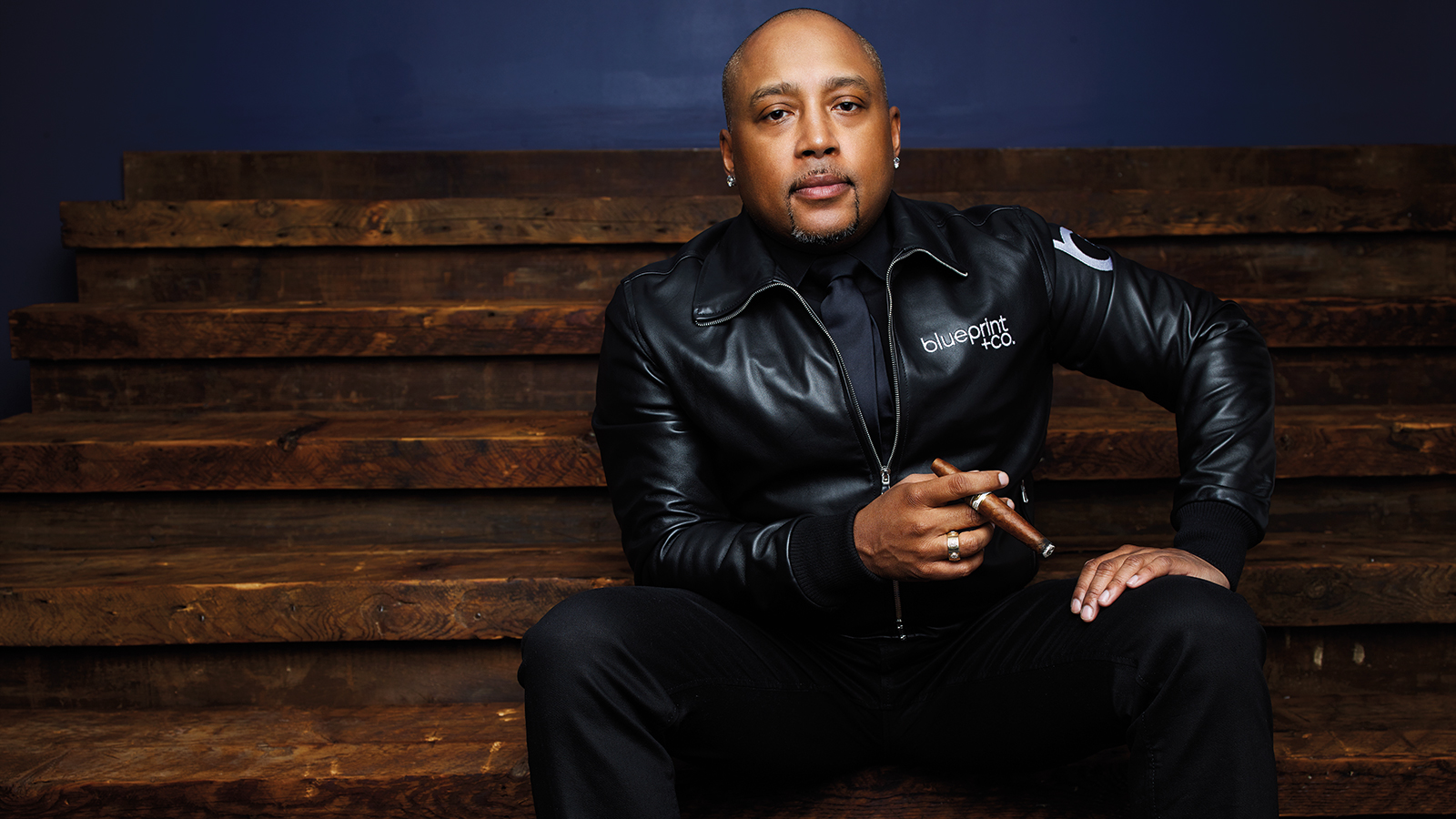 Daymond John in New York City wearing the logo of his latest business venture, blueprint + co.