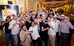 The cigar lovers at the front of the line show off their tickets for the Big Smoke on Friday night.