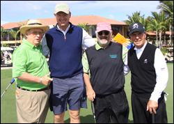 Marvin R. Shanken (second from right), surrounded by golf stars. From left to right, Bob Murphy, Ernie Els, Shanken and Gary Player.