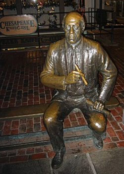 The bronze statue of the Boston Celtics legendary head coach and cigar smoker Red Auerbach at Quincy Market in Boston. Auerbach would most certainly not approve of the new tax proposals.