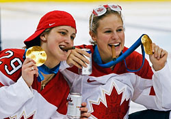 Canada's Marie-Philip Poulin, left, and Tessa Bonhomme pose with cigars and their gold medals during celebrations after their women's ice hockey gold medal game against the U.S. at the Vancouver 2010 Winter Olympics.