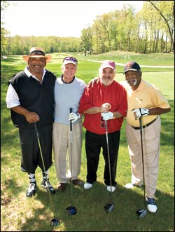 There are happy faces all around as the four senior golfers prepare for a day of competition. From left to right, Jim Thorpe, Michael Douglas, The Shotmaker and Luis Tiant.