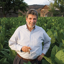 Eduardo Fernández, the owner of Aganorsa S.A., surveys a field of sun-grown, Cuban-seed tobacco in one of the company's many vegas in Nicaragua.