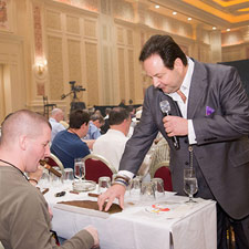 Team La Gloria's Michael Giannini helps an attendee with his wrapper.