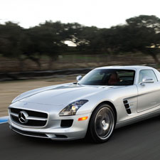 If the new SL seems familiar, it is because Mercedes took styling cues from its SLS supercar, seen here and in interior detail below.
