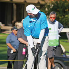 Wearing his trademark gloves, Gainey takes his first tee shot of the Humana Challenge in Palm Springs, California, at the start of the 2013 PGA Tour.