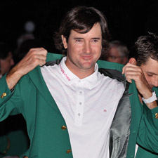 Watson dons the coveted green jacket at the 2012 Masters.