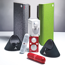 The new world of sending sound through the air comes in many convenient options: Libratone Live speakers (in rear), Phorus (in black), Beats Pill (cylindrical), and Tivoli PAL (stacked at center).