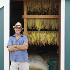 Les Drent, owner of Kauai Cigar Co., takes stock of a curing barn brimm