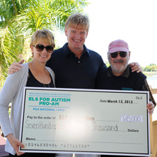 Liezl and Ernie Els with editor and publisher Marvin R. Shanken.