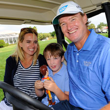 Pro golfer Ernie Els and his wife, Liezl, with son Ben.