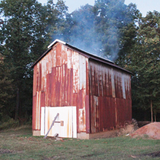 "Fire-cured, or ""dark fired"" tobacco, is actually cured in barns in a similar process to that of candela wrappers."