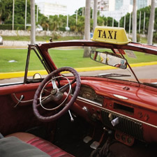 Old American cars serve as taxis in Havana.