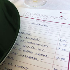 The handwritten menu at Le Chansonnier changes daily, but usually has standard fish, chicken and pork dishes.