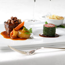 Beef Two Ways: A pecan crusted barbecued short rib paired with a miniature filet mignon wrapped in Swiss chard.