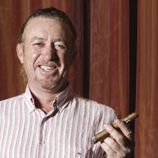 Miguel Angel Jimenez holds a cigar. Jimenez keeps about 400 cigars in his home humidor, mostly Cubans.