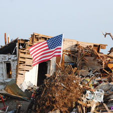 An American flag flies in Joplin, Missouri, after an EF5 tornado recently destroyed huge areas of the city.