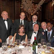 Joining Marvin R. Shanken at the head table were wife Hazel and, from left to right, former New York City mayor Rudy Giuliani, Michael Milken, Chuck Wagner, Rush Limbaugh and John Salley.