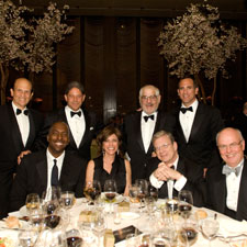 Seated at the head table was,standing left to right, Michael Milken, Bill Terlato, Marvin R. Shanken, Jorge Padrón, and seated, Gordon Mott, Jeff Greenfield, Hazel Shanken and John Salley.