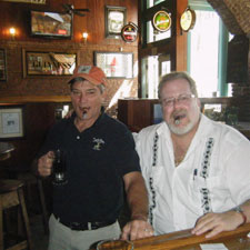 Fred Remington, left, co-owner of O'Toole's Pub, with writer Alejandro Benes.