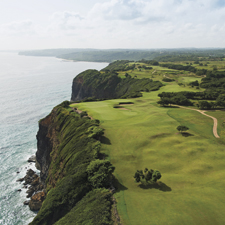 The 12th and 14th holes of Royal Isabela hover above the Atlantic Ocean on the northwest corner of Puerto Rico, and meet at a dramatic double green.