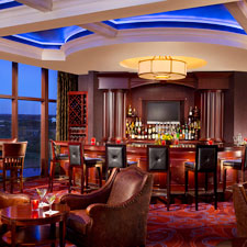 The bar in TS Steakhouse is adjacent to a cozy smoking parlor and an outdoor terrace where smoking is encouraged.