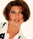 Scantily clad and flaunting a cigar, Linda Evangelista gives new definition to cigar smoking in her unforgettable photo shoot for Cigar Aficionado. Sexy and seductive, the Canadian-born supermodel radiates with beauty, and her grace and allure truly make her a model of perfection.